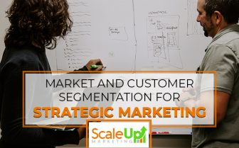 """blog title """"Market And Customer Segmentation For Strategic Marketing"""" a header with a background of two men writing on a whiteboard"""