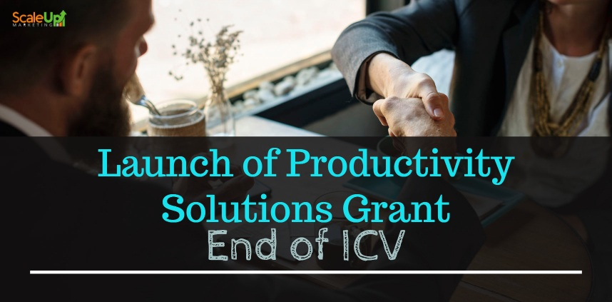 """header image of the blog title """"Launch of Productivity Solutions Grant End of ICV"""" with an overhead shot of a man wearing corporate attire shaking hands to another person"""