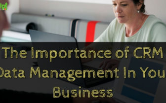"header image of the blog title ""The Importance of CRM Data Management In Your Business"" with an overhead shot of a man and a woman in front of him typing something on a laptop"