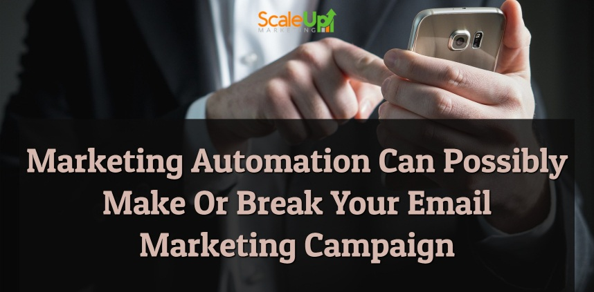 """header image of the blog title """"Marketing Automation Can Possibly Make Or Break Your Email Marketing Campaign"""" with a person only half of it's body shown wearing corporate attire while holding a mobile phone on his left hand"""