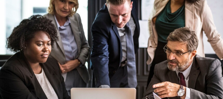 5 persons: 2 women and 3 men wearing corporate attires looking directly to a single laptop in front, this is an example of tracking customer interaction