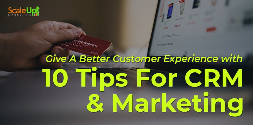 """header image of the blog title """"Give A Better Customer Experience with 10 Tips For CRM & Marketing"""" with a laptop and a hand holding a card"""
