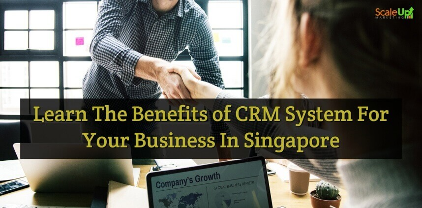 """header image of the blog title """"Learn the Benefits of CRM System For Your Business in Singapore"""" with an over-the-shoulder shot of a person shaking hands with a guy, this indicates that small businesses needs to know the CRM system in singapore"""
