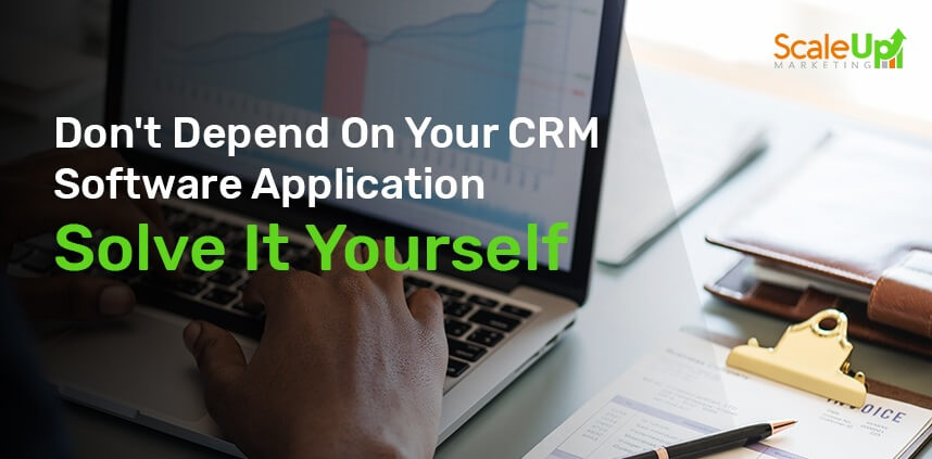 """header image of the blog title """"Don't Depend On Your CRM Software Application Solve It Yourself"""" with a close-up shot of a hand typing on a laptop"""