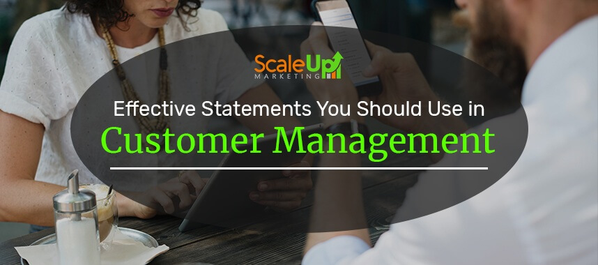 "header image of the blog title ""Effective Statements You Should Use in Customer Management"" with a background image of two persons facing each other holding a phone and tablet on a wooden table"