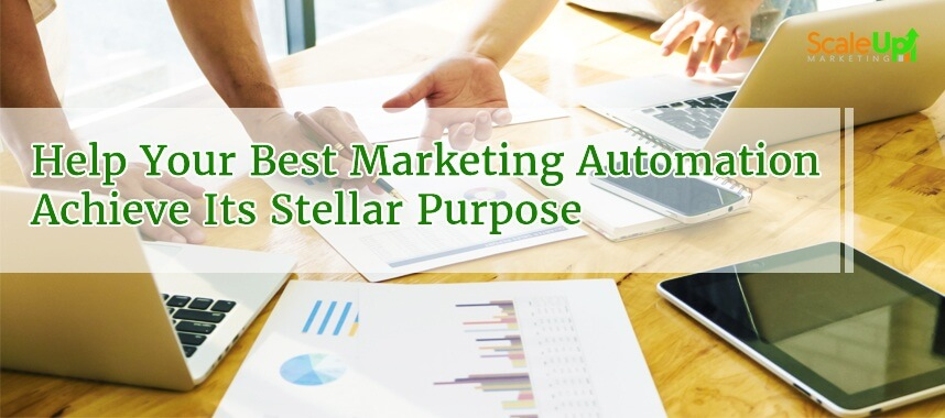"""header image of the blog title """"Help Your Best Marketing Automation Achieve Its Stellar Purpose"""" with an over-the-head shot of two persons discussing on a wooden surface"""