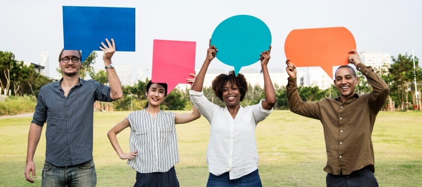 4 persons holding a dialogue boxes above their heads