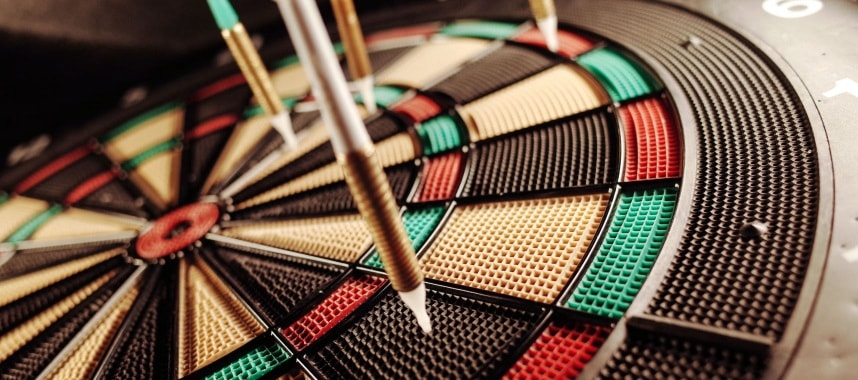 4 golden pin separately nailed on a colorful dart board