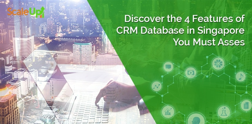 """header image of the blog title """"Discover the 4 Features of CRM Database in Singapore You Must Asses"""" with skyview shot of buildings with a blurry image of a hand resting on a laptop's keyboard"""