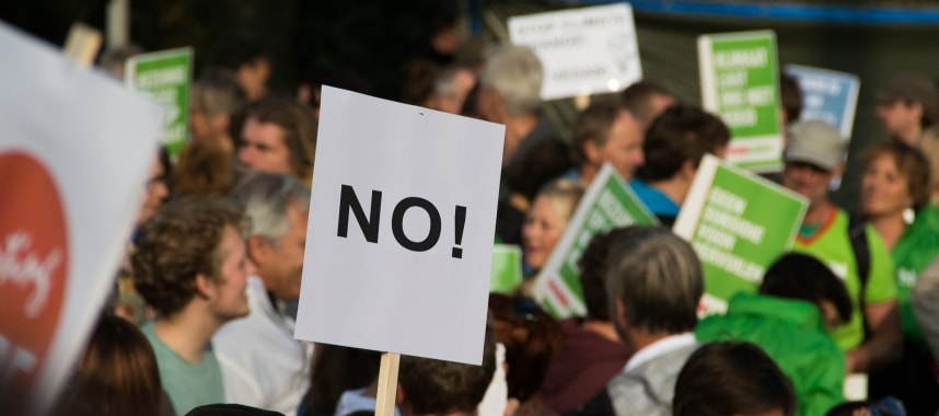image of people holding rally boards indicating spam complaints