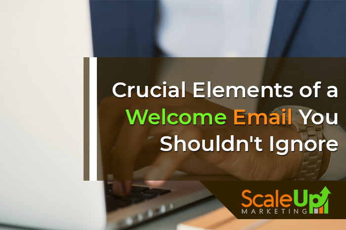 """blog title """"CRUCIAL ELEMENTS OF A WELCOME EMAIL YOU SHOULDN'T IGNORE"""" a header with a header of a mans hand typing on alaptop"""
